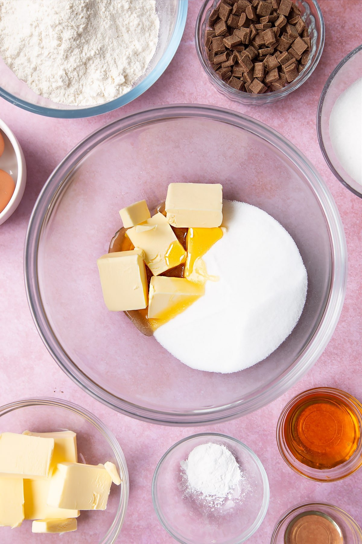 Overhead shot of butter, golden syrup, vanilla and sugar in a large mixing bowl