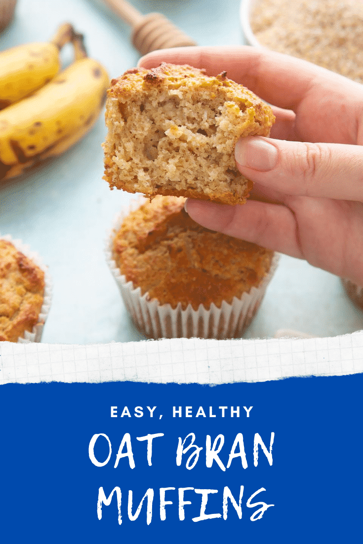 Front angle shot of a hand holding a half eaten breakfast muffin with graphic text EASY, HEALTHY OAT BRAN MUFFINS below