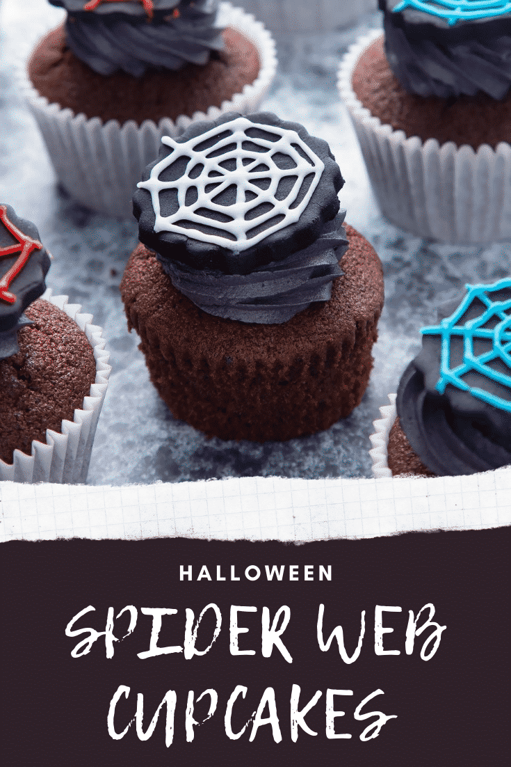 Spider web cupcakes arranged on a black surface. The chocolate sponge cupcakes are topped with purple vanilla buttercream and discs of black sugar paste decorated with spider web icing. Caption reads: Halloween spider web cupcakes