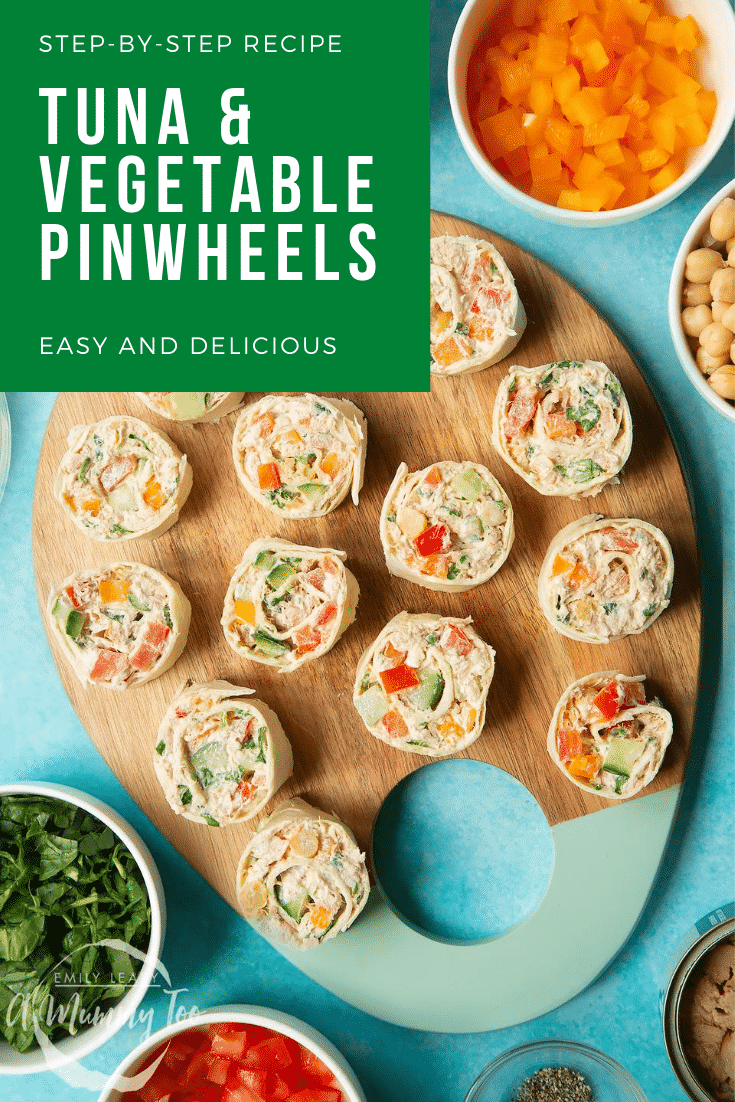 Tuna pinwheels on a board with fresh fruit and veg around it. Caption reads: step-by-step recipe tuna & vegetable pinwheels easy & delicious