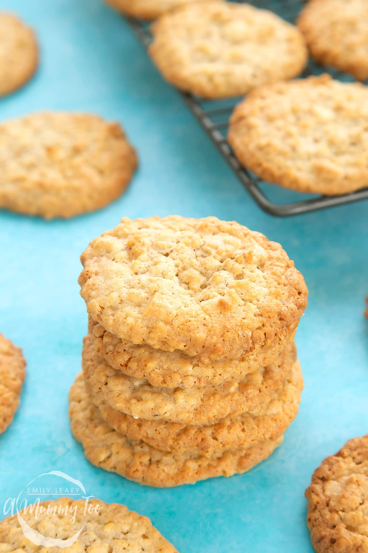 Front view shot of a stack of white chocolate chip oatmeal cookies