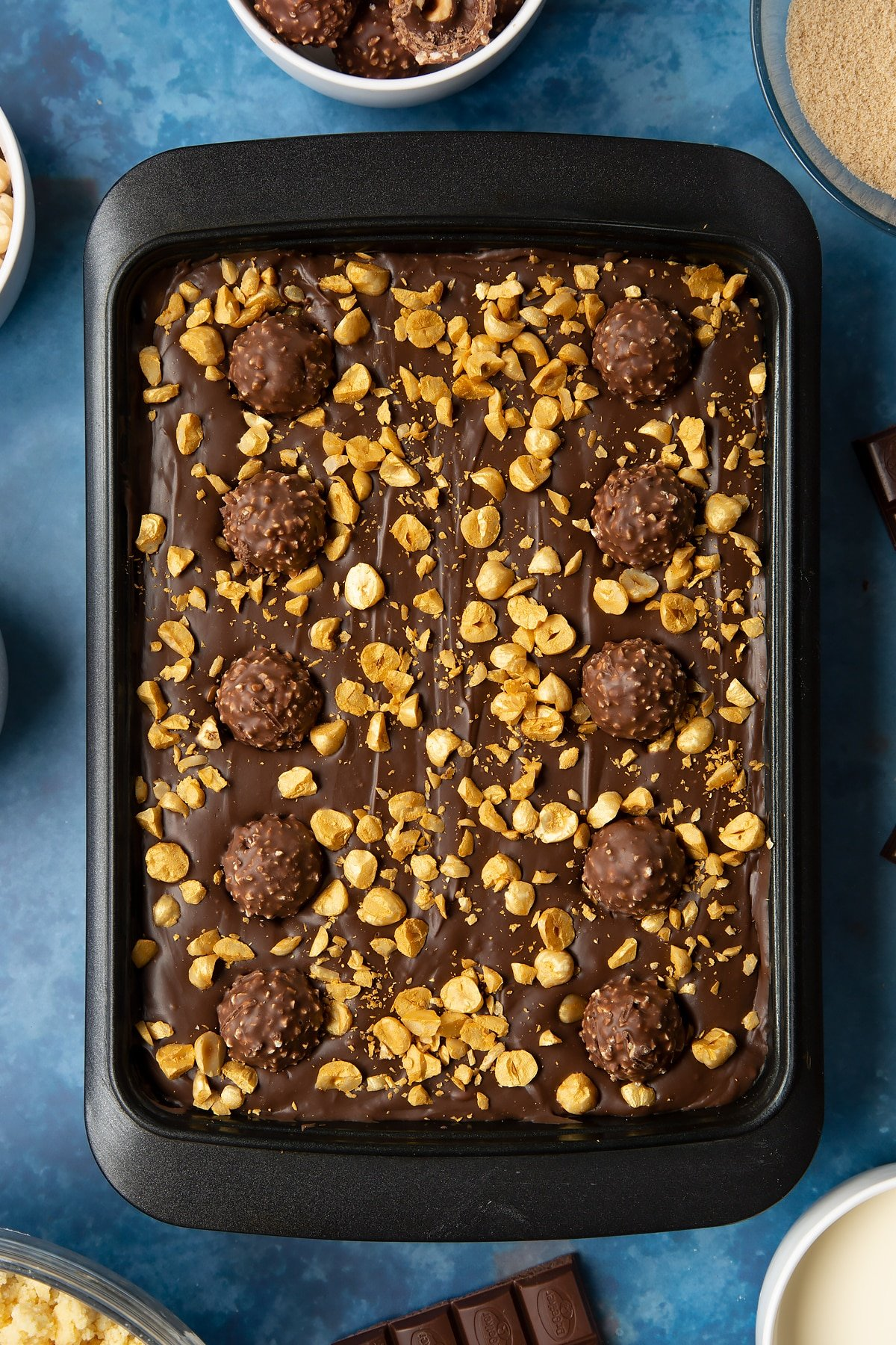 Finished and chilled Ferrero Rocher slice in a tray.