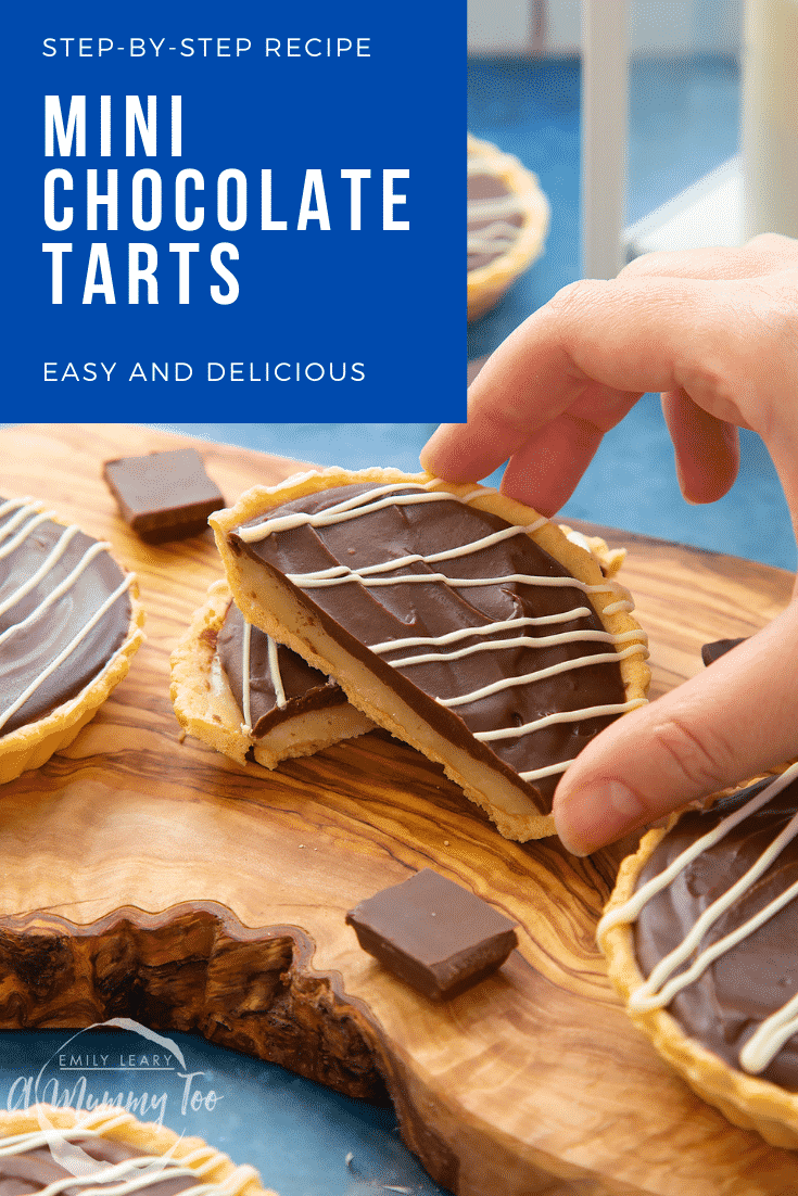 Mini chocolate tarts on an olive board. One tart has been cut in half. A hand holds a half. Caption reads: step-by-step recipe mini chocolate tarts easy and delicious