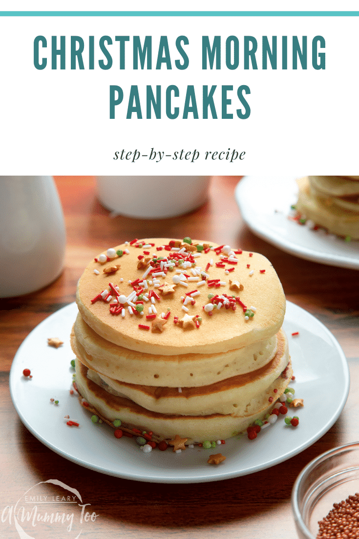 A tall stack pancakes, stacked on a white plate, scattered with festive sprinkles and drizzled with cream. Caption reads: Christmas morning pancakes step-by-step recipe