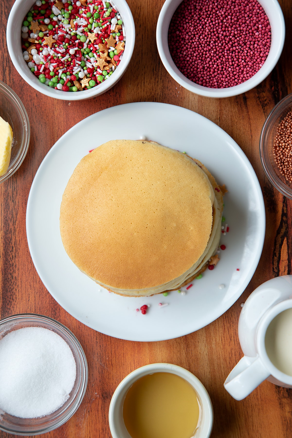 Christmas morning pancakes, stacked on a white plate.