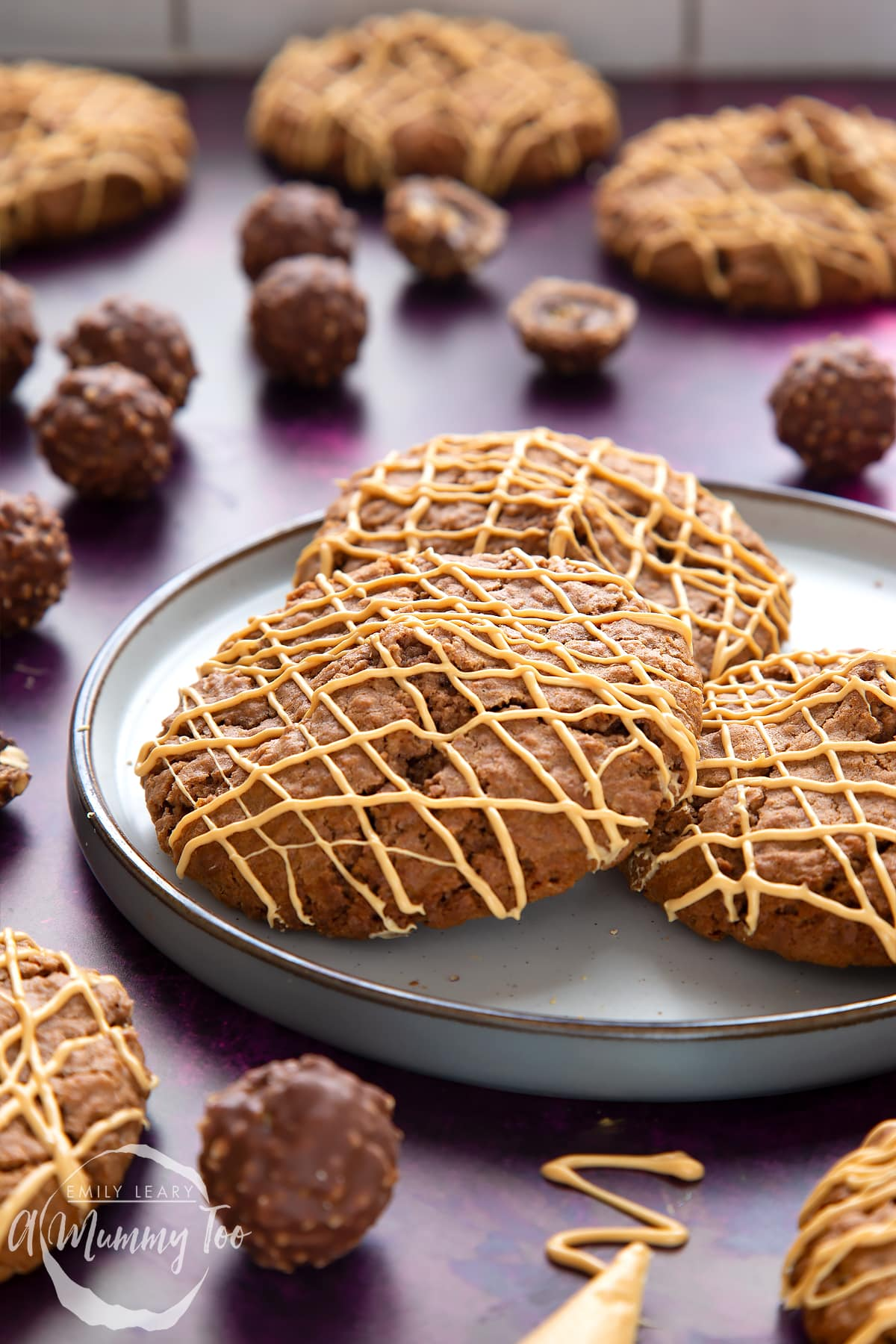 Ferrero Rocher cookies on a plate. They are decorated with golden white chocolate.
