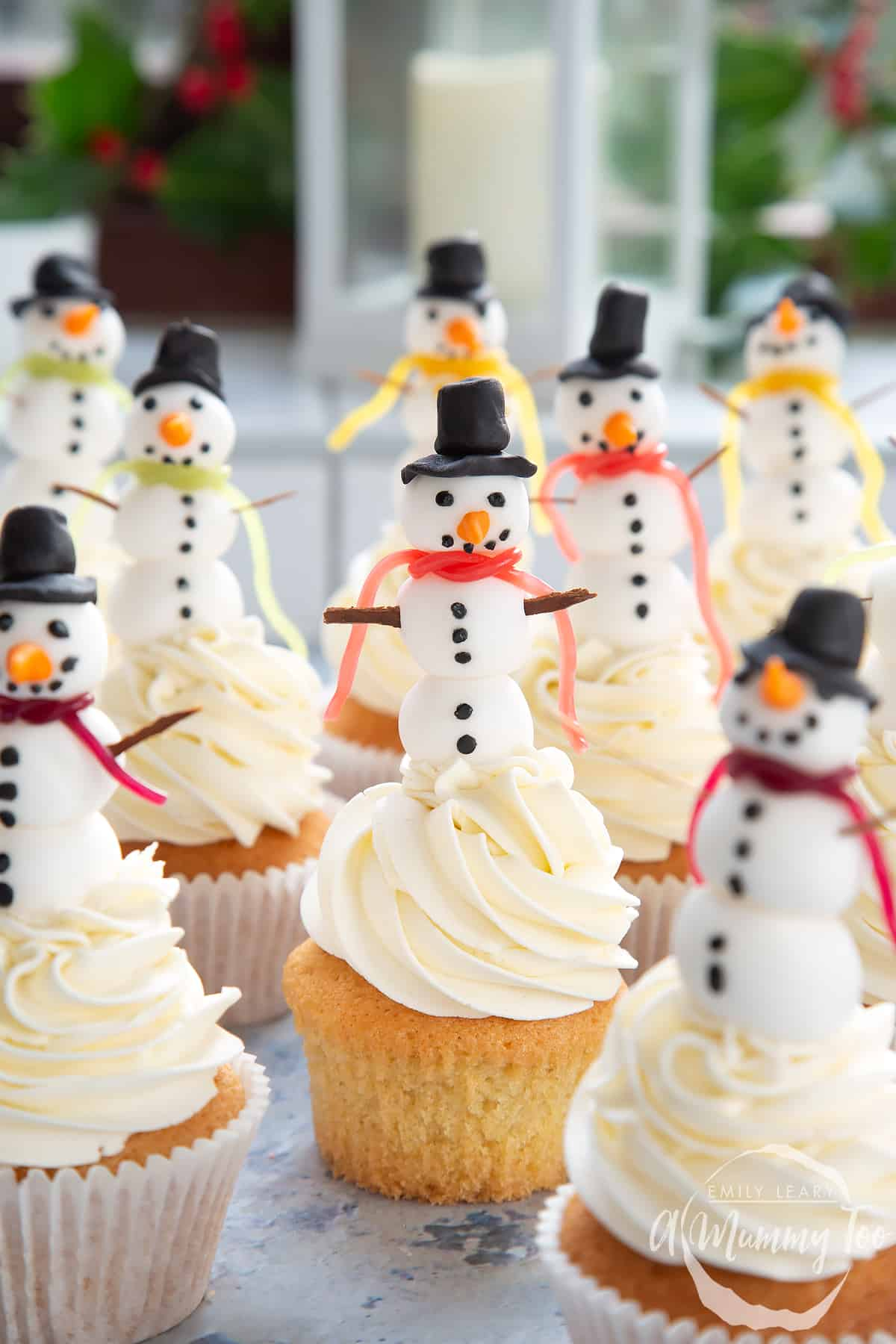 Multiple snowman cupcakes.