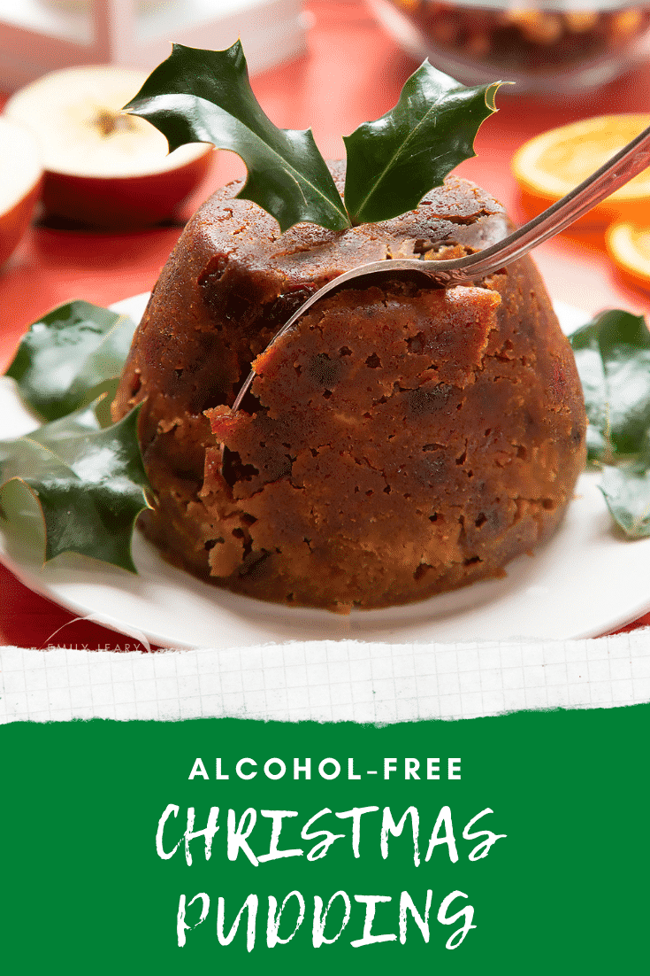 Front angle shot of Christmas pudding with a fork going into the side. At the bottom of the image there's some text describing the image for Pinterest.
