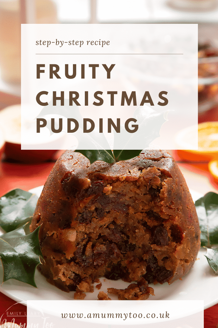 Forward shot of a Christmas pudding cut open on a white plate with some text describing the image for Pinterest.
