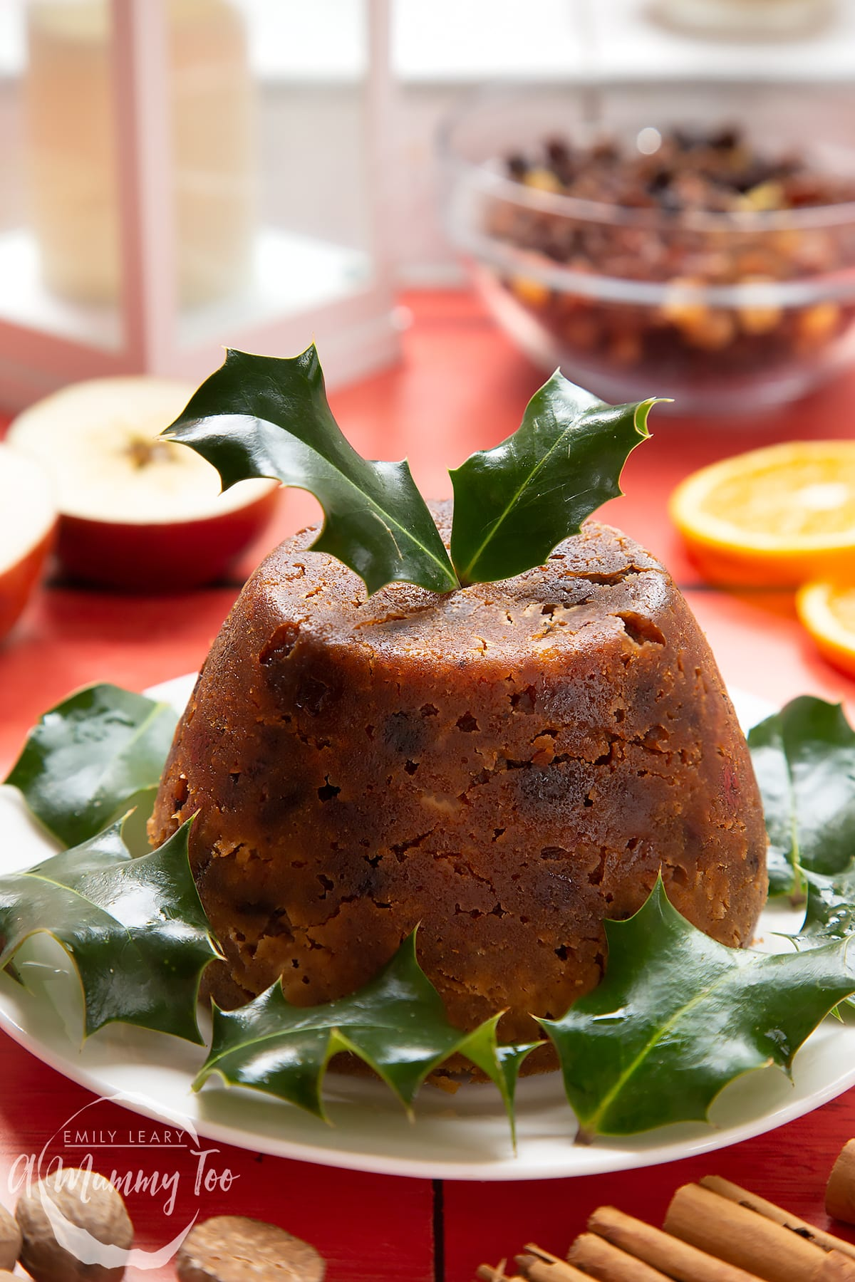 Front angle shot of Alcohol-free Christmas pudding served on a white plate with a mummy too logo in the lower-left corner