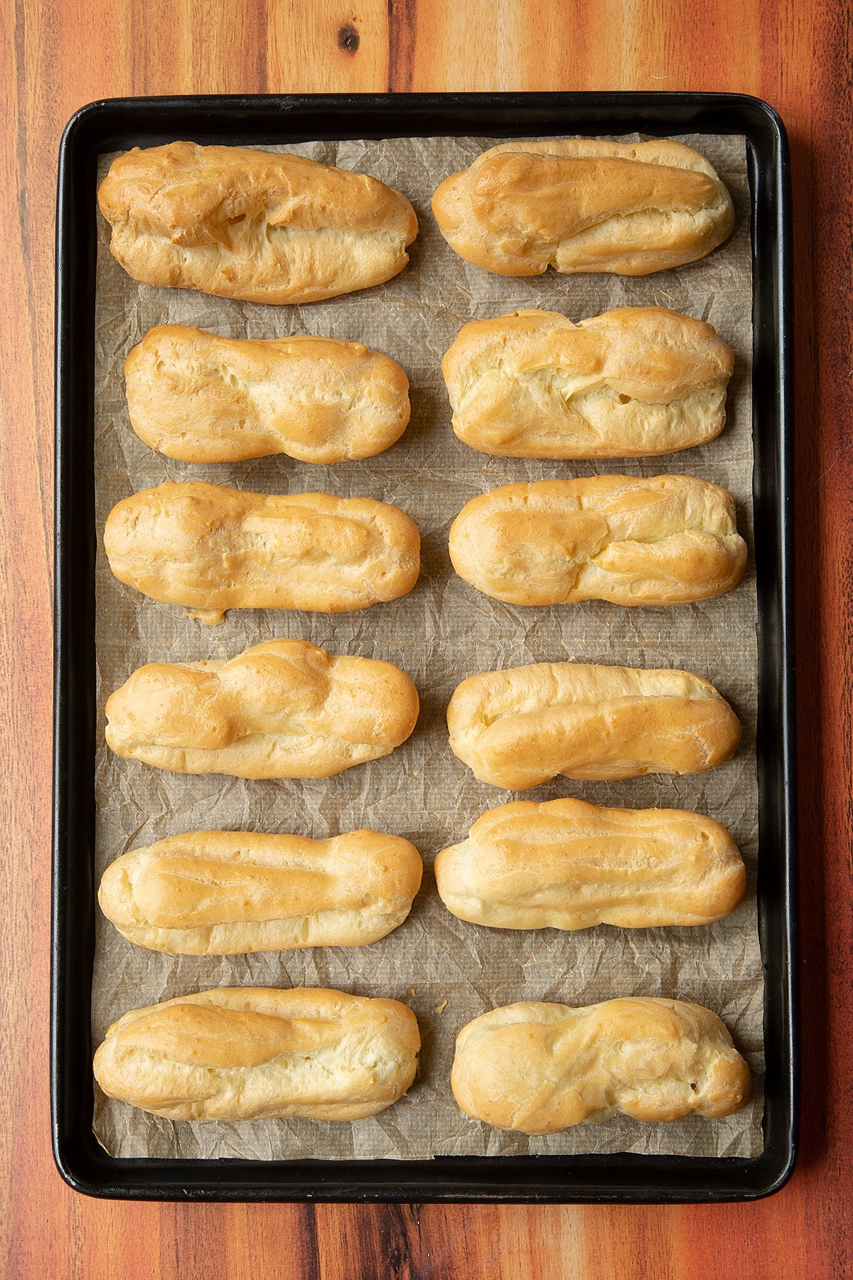 Overhead shot of a baked choux pastry on a baking tray.