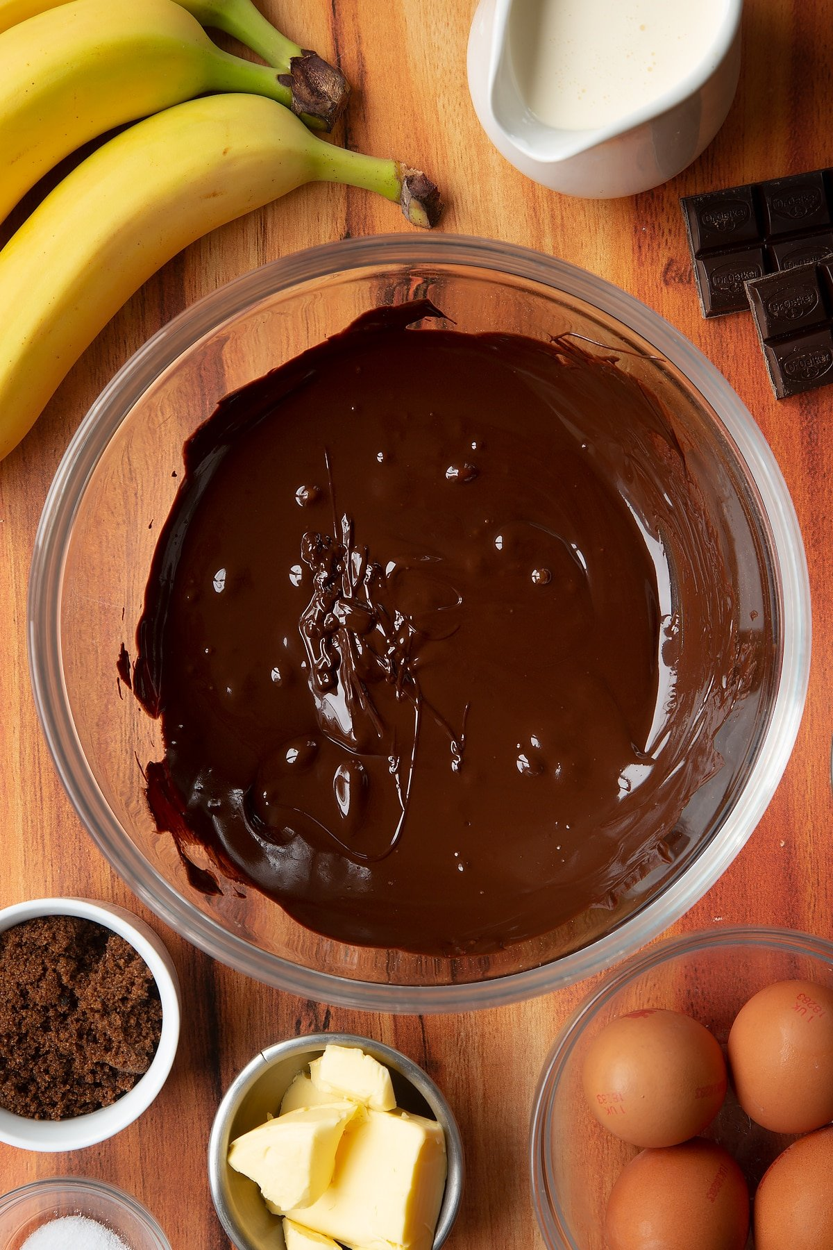 Melted chocolate in a clear mixing bowl.