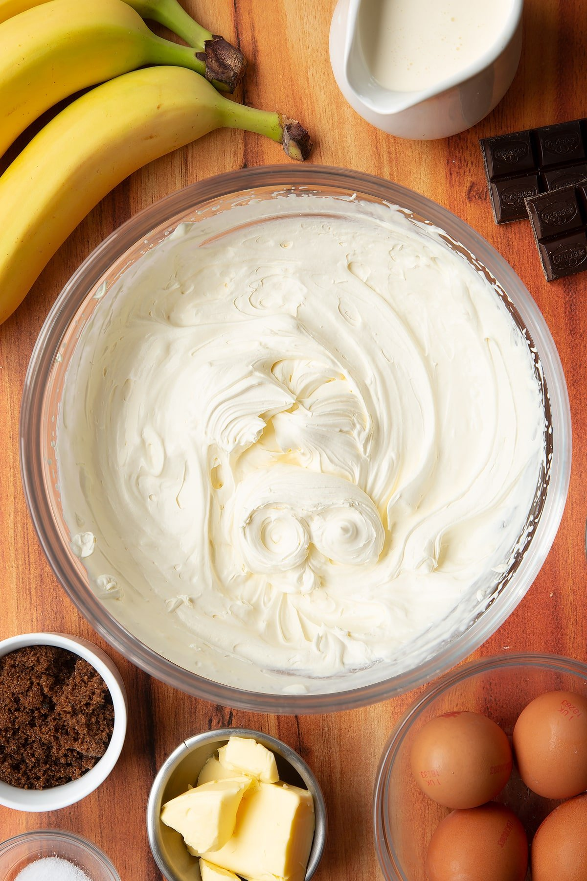 Whipped cream mixed in a mixing bowl.
