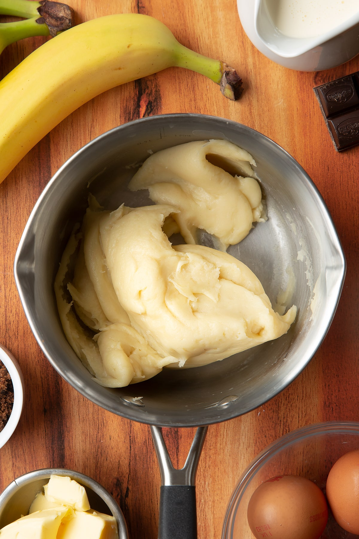 Overhead shot of choux pastry dough in a pan