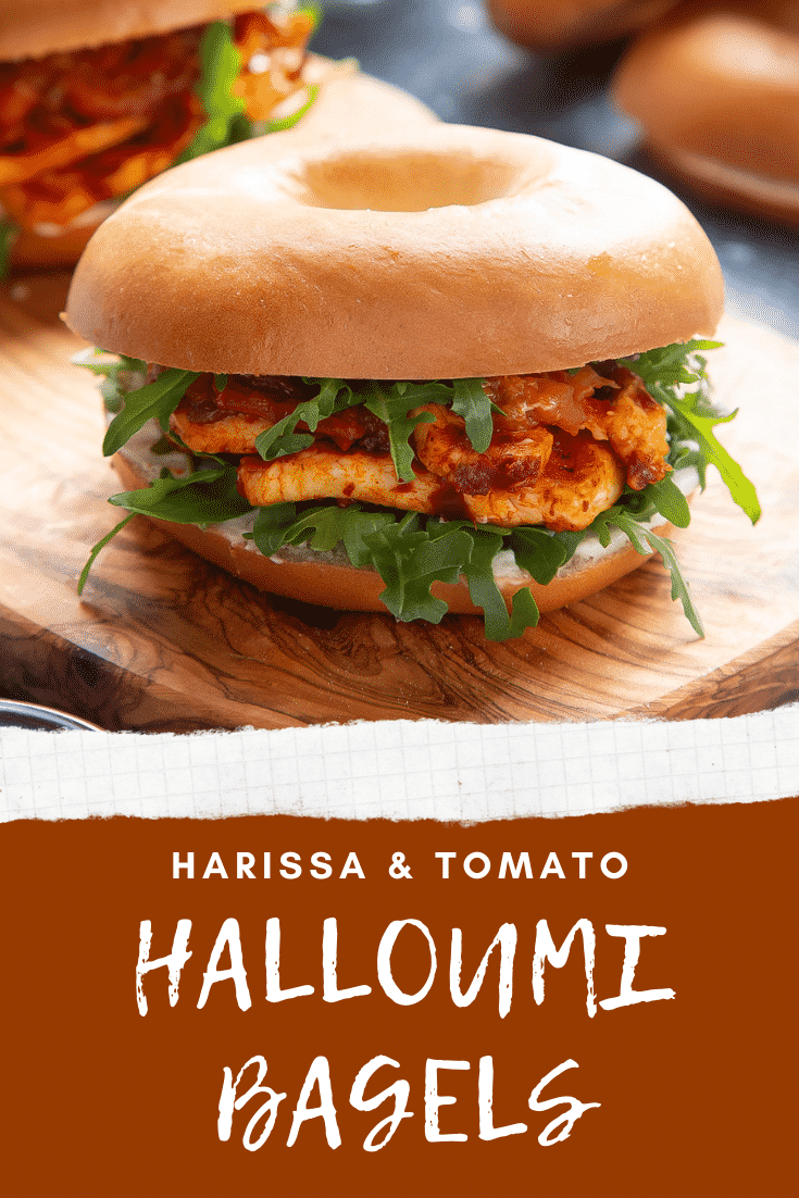 Halloumi bagels on a wooden board. Caption reads: harissa & tomato halloumi bagels