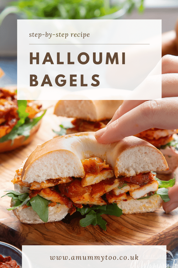 Two halloumi bagels on a wooden board. One is cut in half and a hand reaches for it. Caption reads: step-by-step recipe halloumi bagels