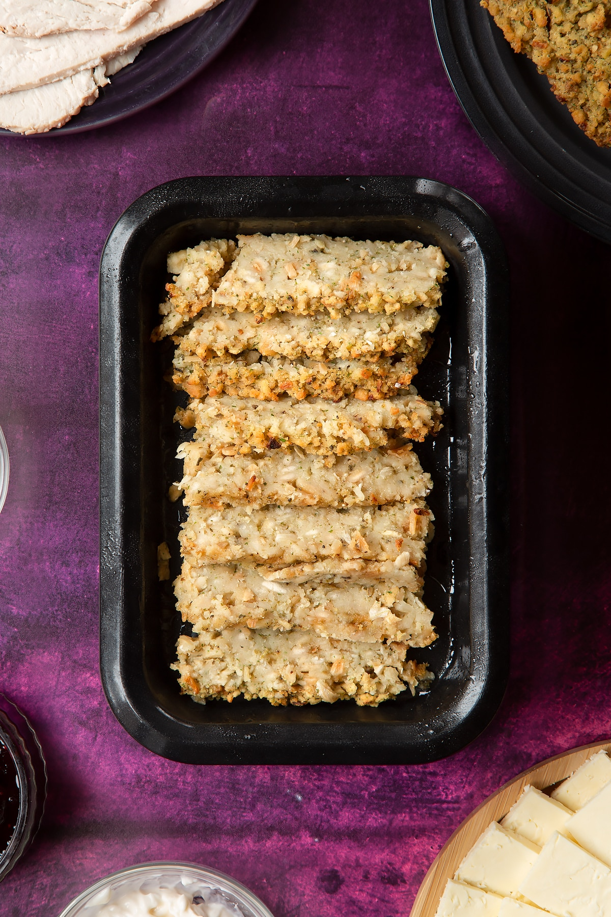 Overhead shot of sliced stuffing in a  greased oven tray