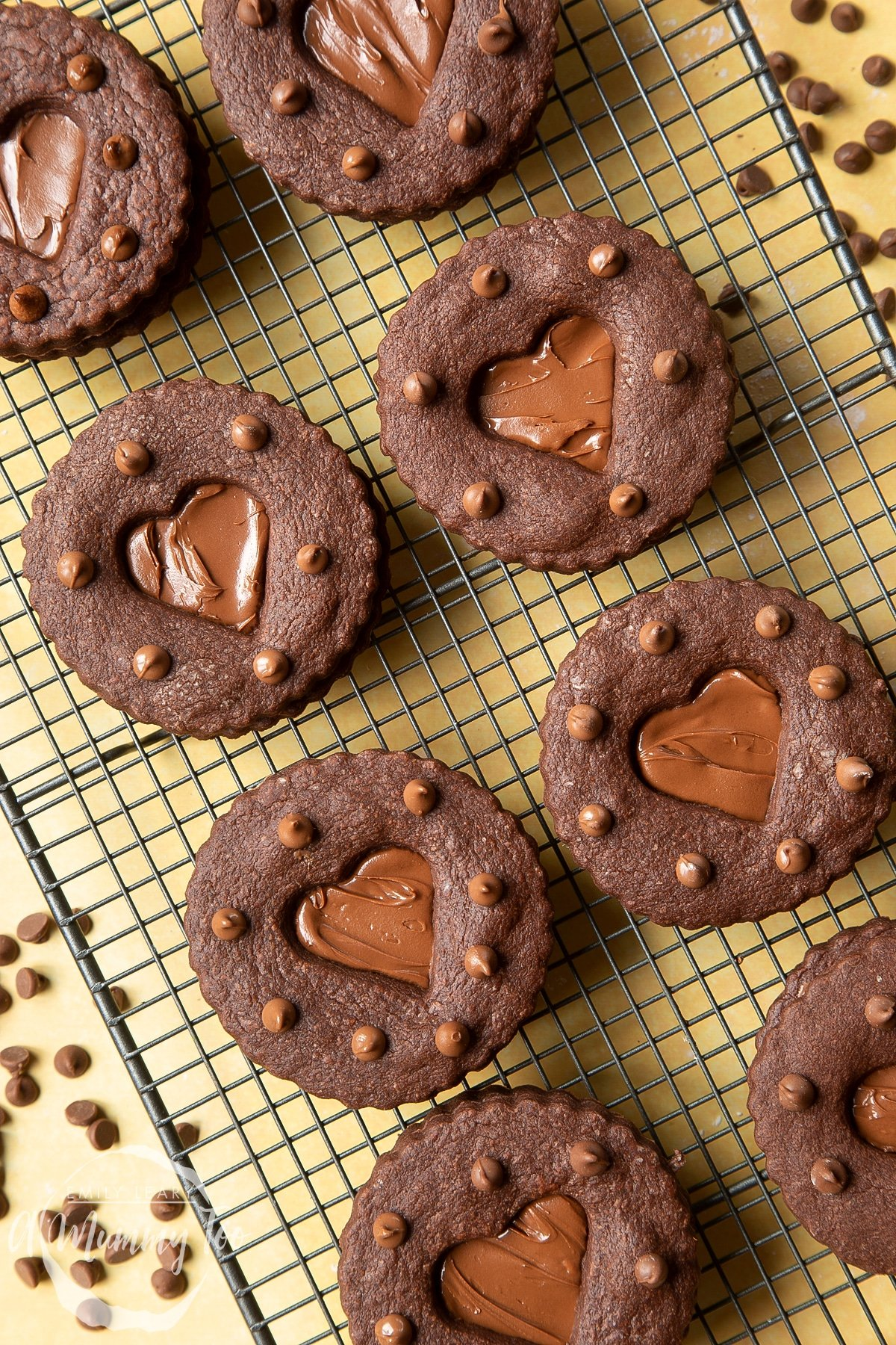 Nutella sandwich cookies on a cooling rack.