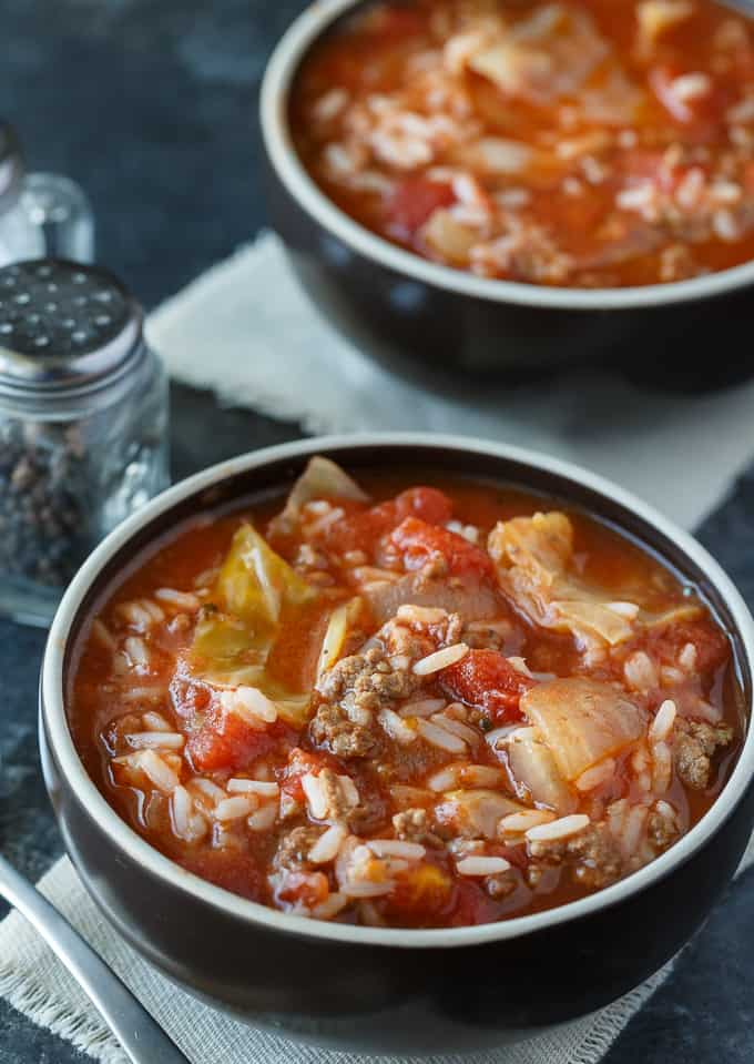 A black bowl filled with Cabbage Roll Soup.
