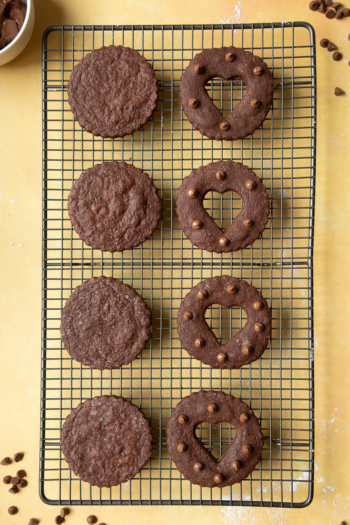 Chocolate sandwich cookies on a cooling rack ready to fill assemble.