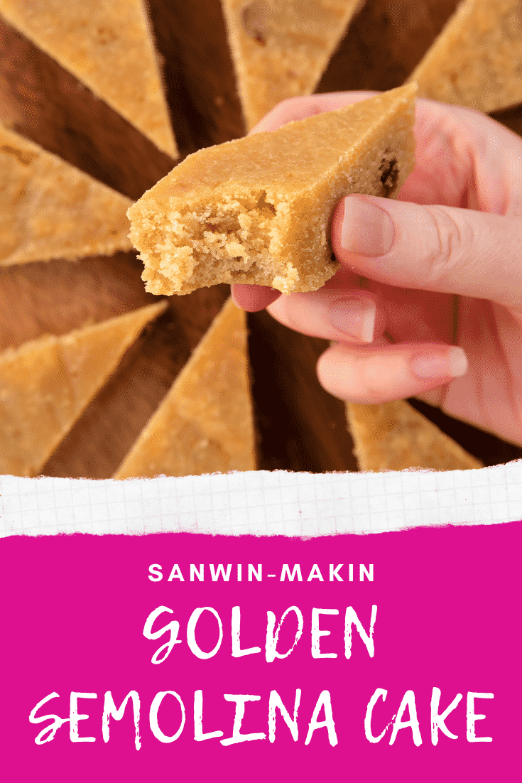 Hand holding a piece of sanwin-makin with a bite out of it. More is shown on a wooden board. Caption reads: Sanwin-makin golden semolina cake