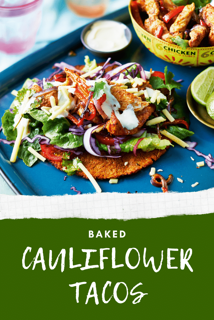 A cauliflower taco with salad and chicken on a blue tray. A bowl of chicken and vegetable filling is shown in the background. The caption reads: Baked cauliflower tacos