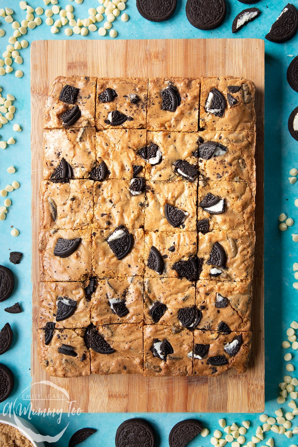 Overhead shot of Baked Oreo Blondie cut into squares on a wooden board
