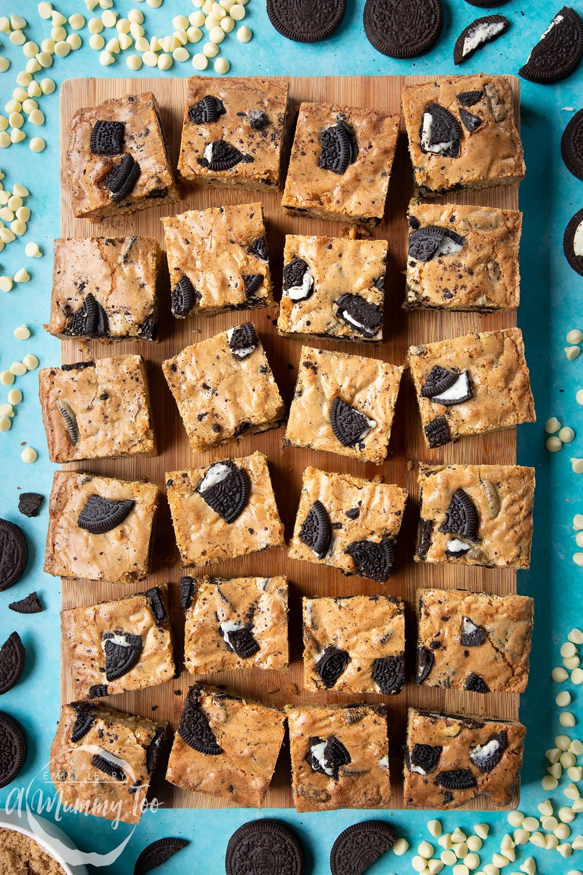 Overhead shot of square cut oreo blondies on a wooden board