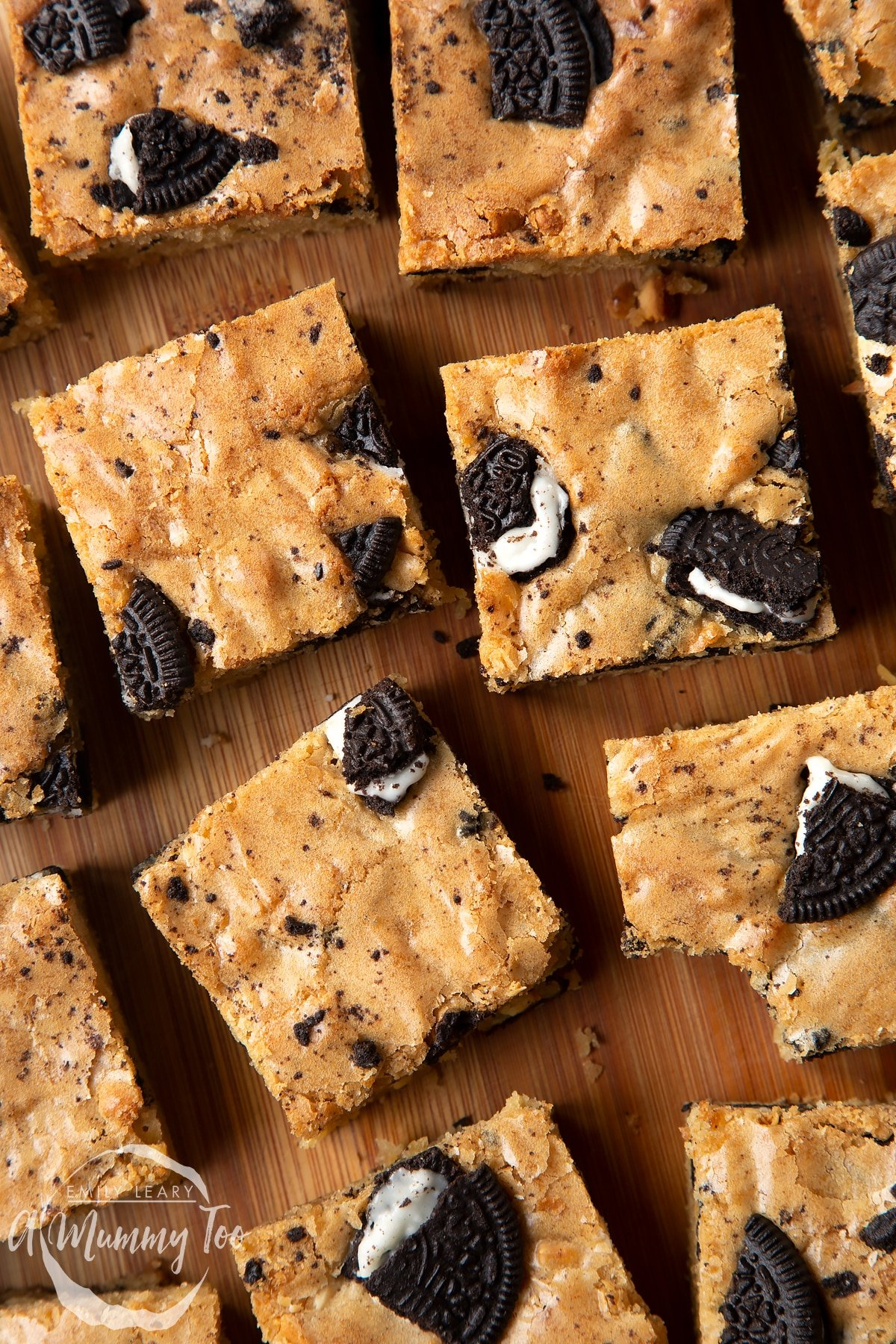 Overhead shot of square Oreo Blondies on a wooden board with the A Mummy Too logo in the corner