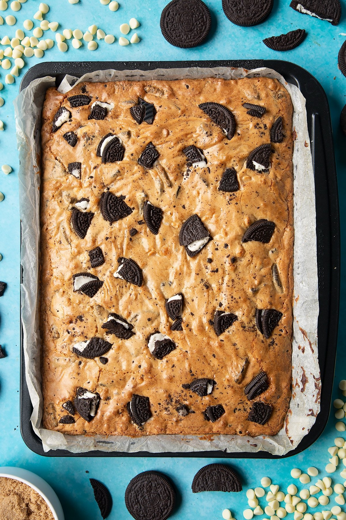 Overhead shot of baked Oreo Blondie in a lined baking tray