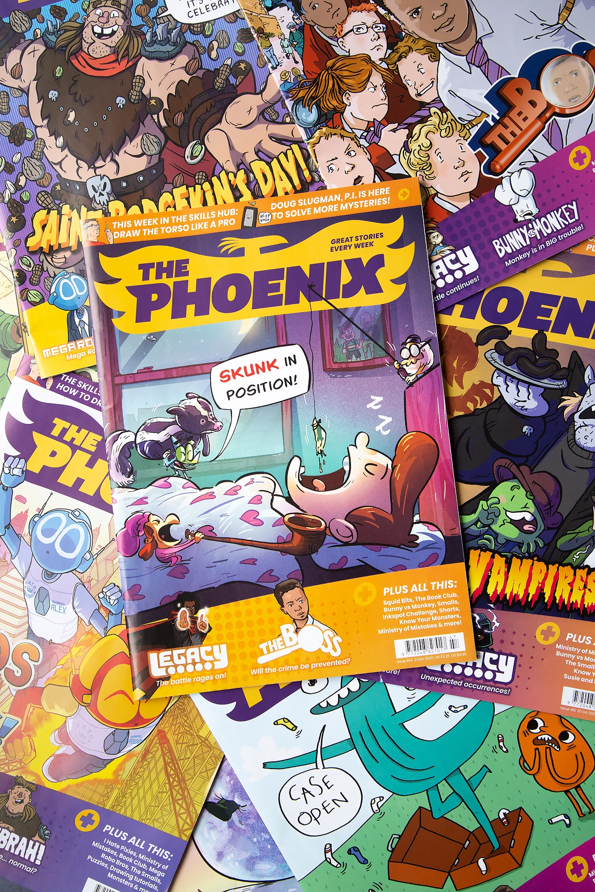 Overhead shot of The Phoenix magazine on a backdrop of other animated magazines