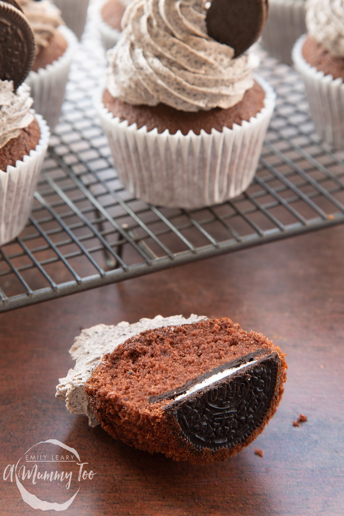Front view shot of half a chocolate cupcake with oreo buttercream