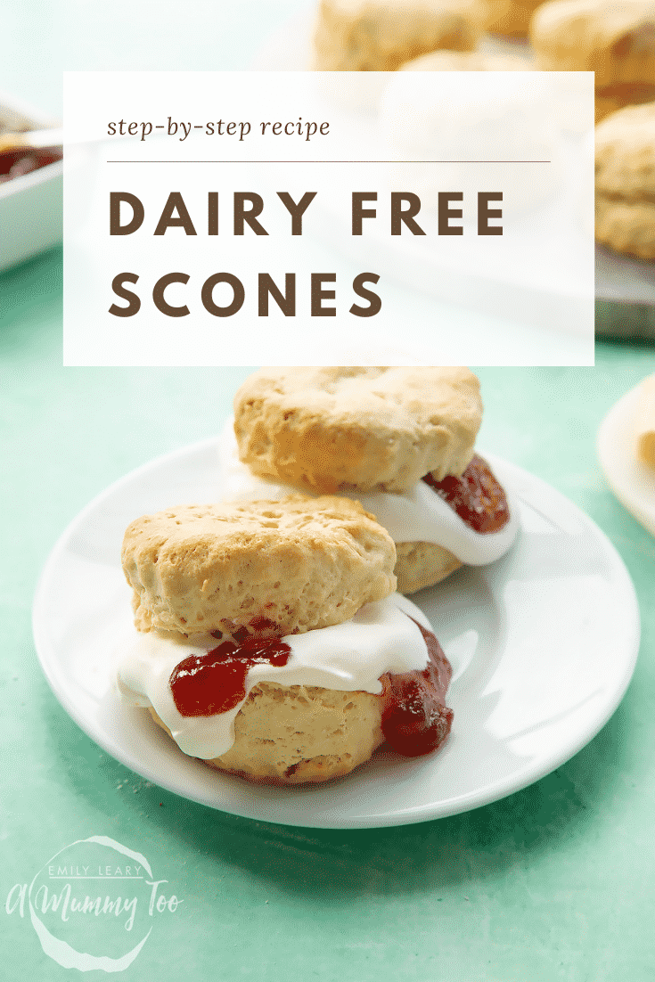 Two dairy free scones on a white plate. They are filled with jam and vegan whipped cream. Caption reads: step-by-step recipe dairy free scones