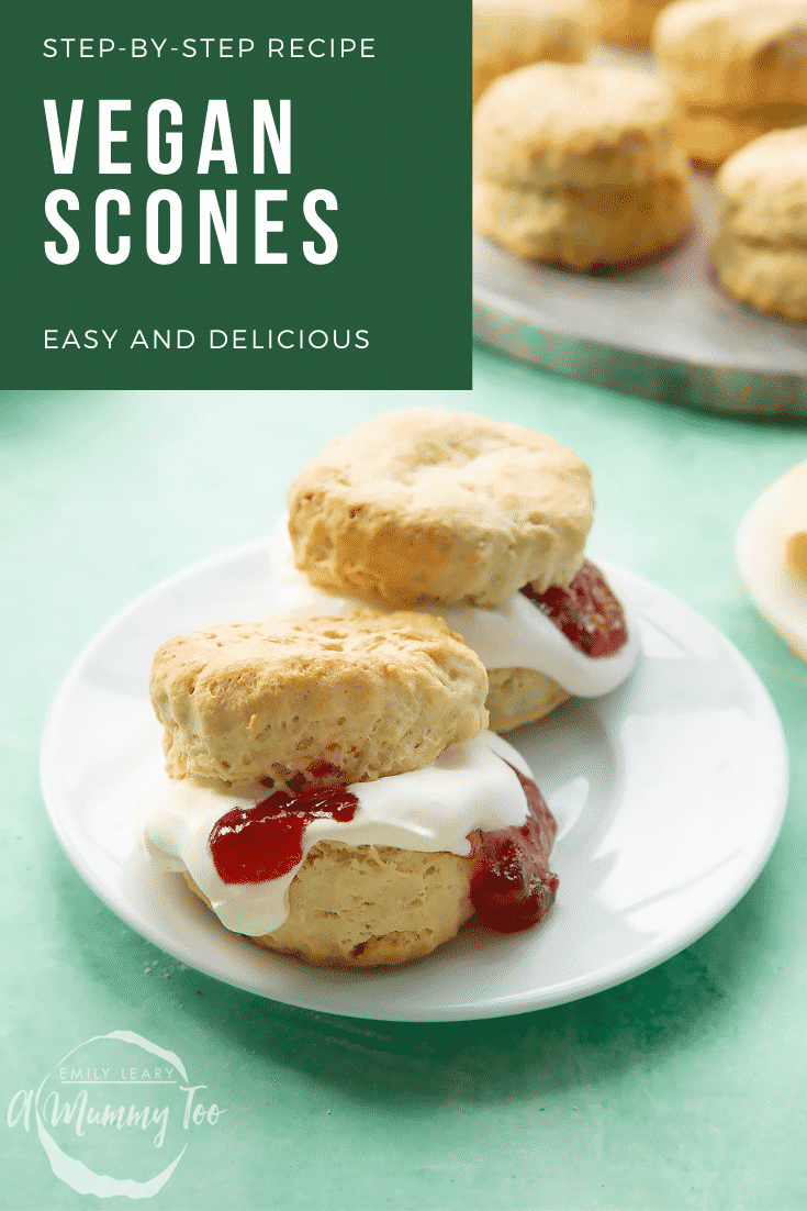 Two dairy free scones on a white plate. They are filled with jam and vegan whipped cream. Caption reads: Step-by-step recipe vegan scones easy and delicious.