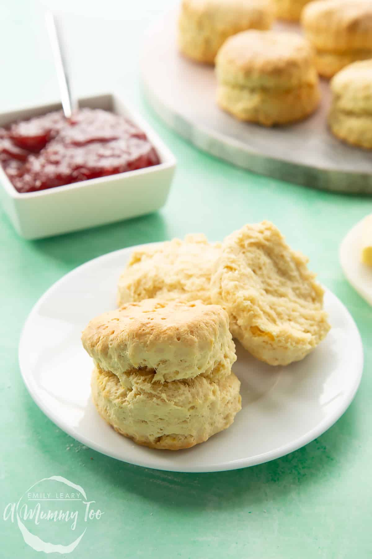 Two dairy free scones on a white plate.