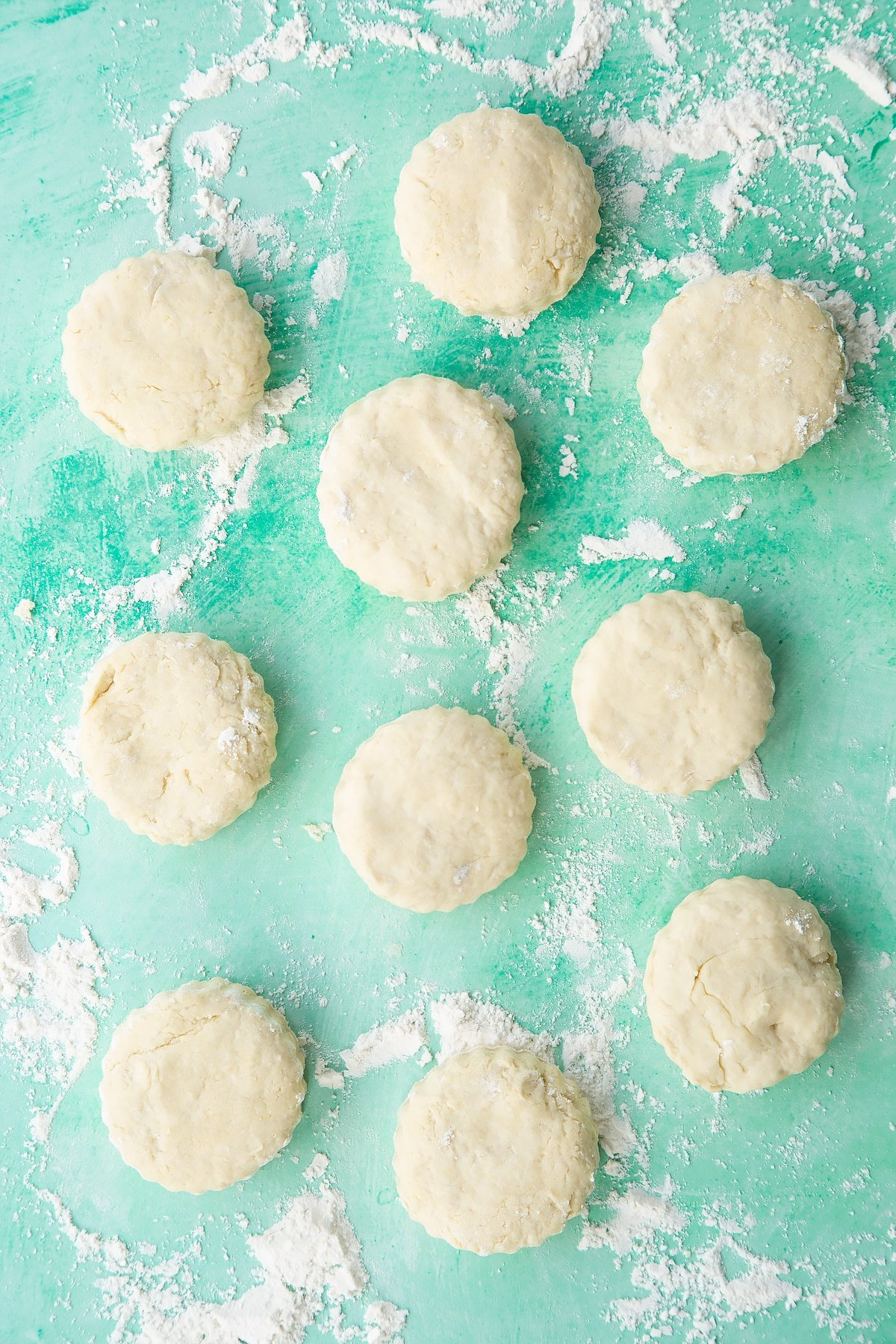 Dairy free scone rounds on a floured surface.