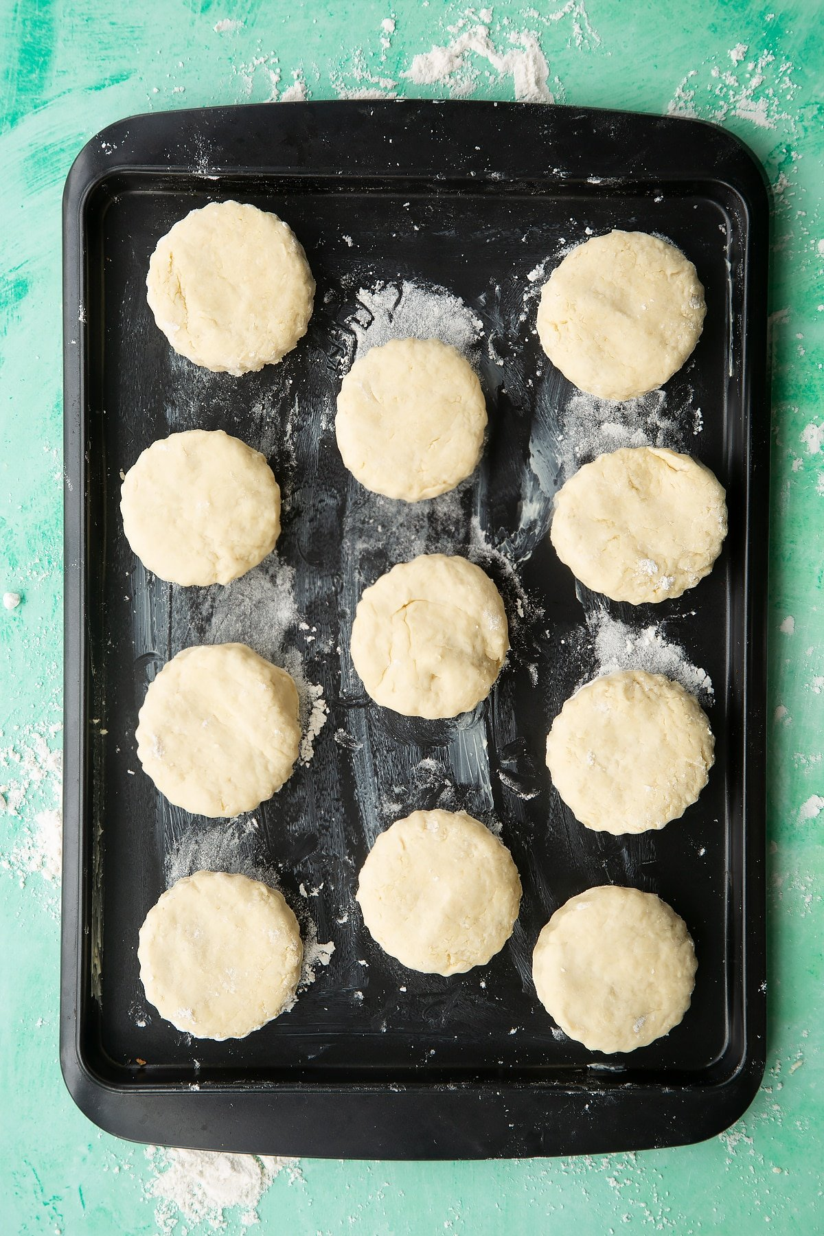 Dairy free scone rounds on a greased baking tray.