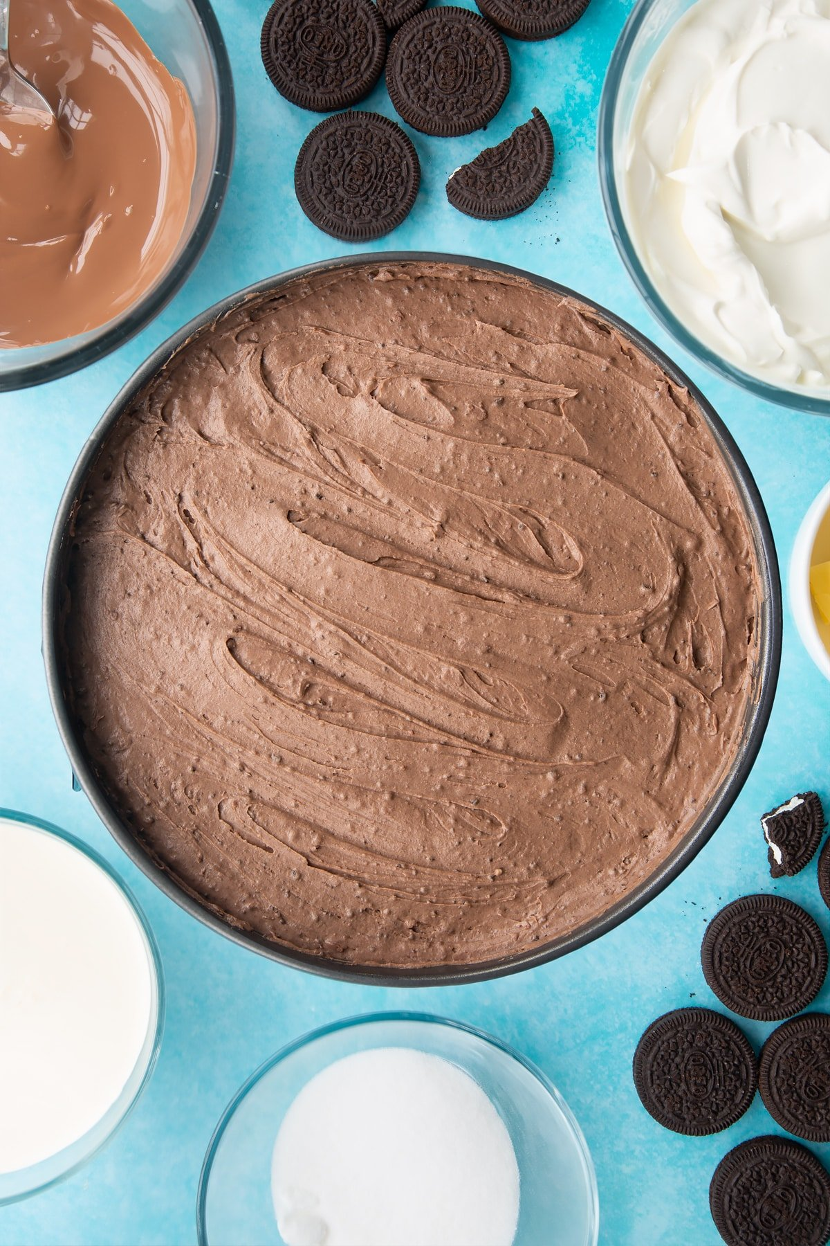 Overhead shot of whipped cheesecake topping in a large cake tin