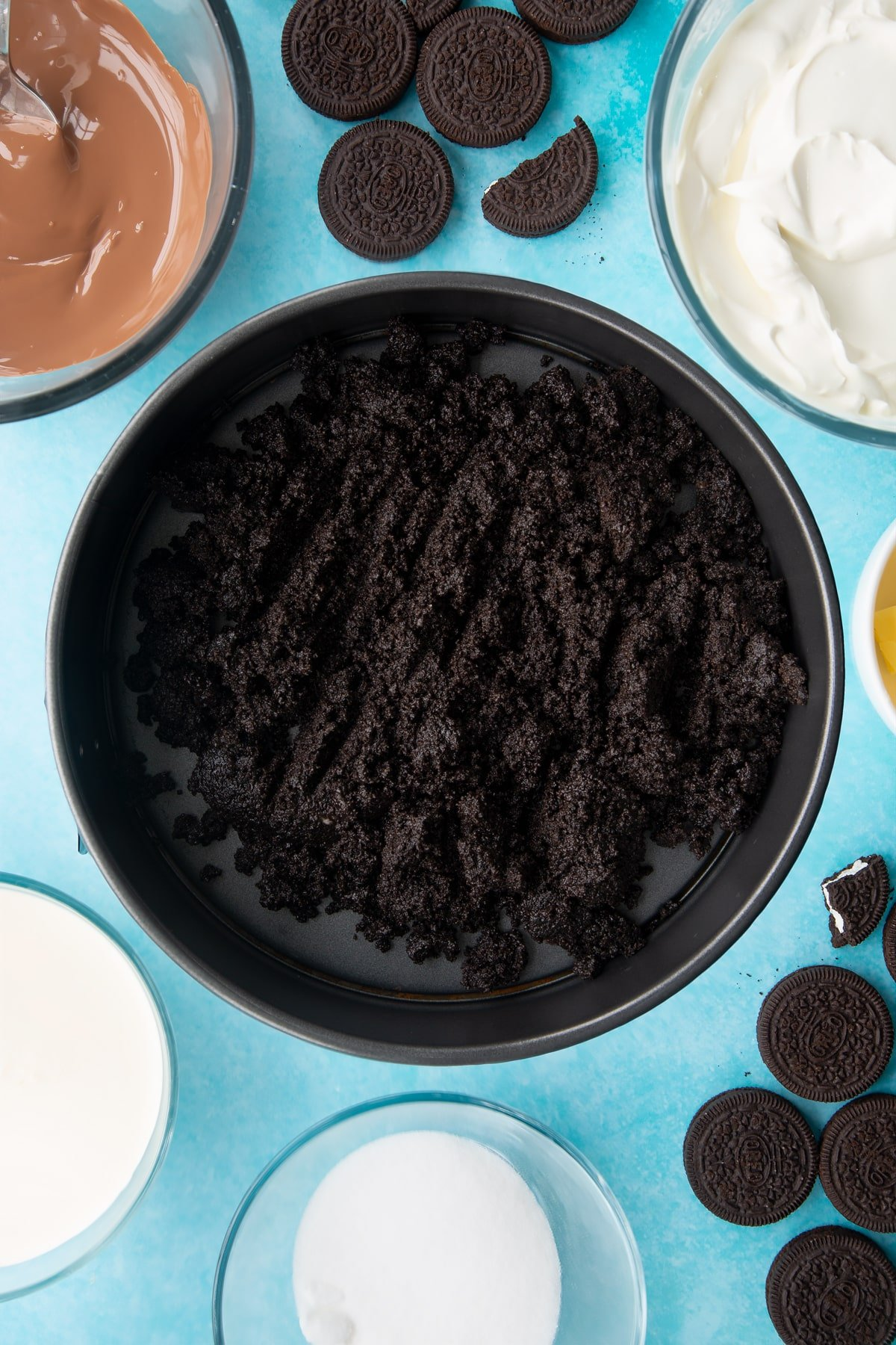 Overhead shot of oreo biscuits crumb in a large cake tin