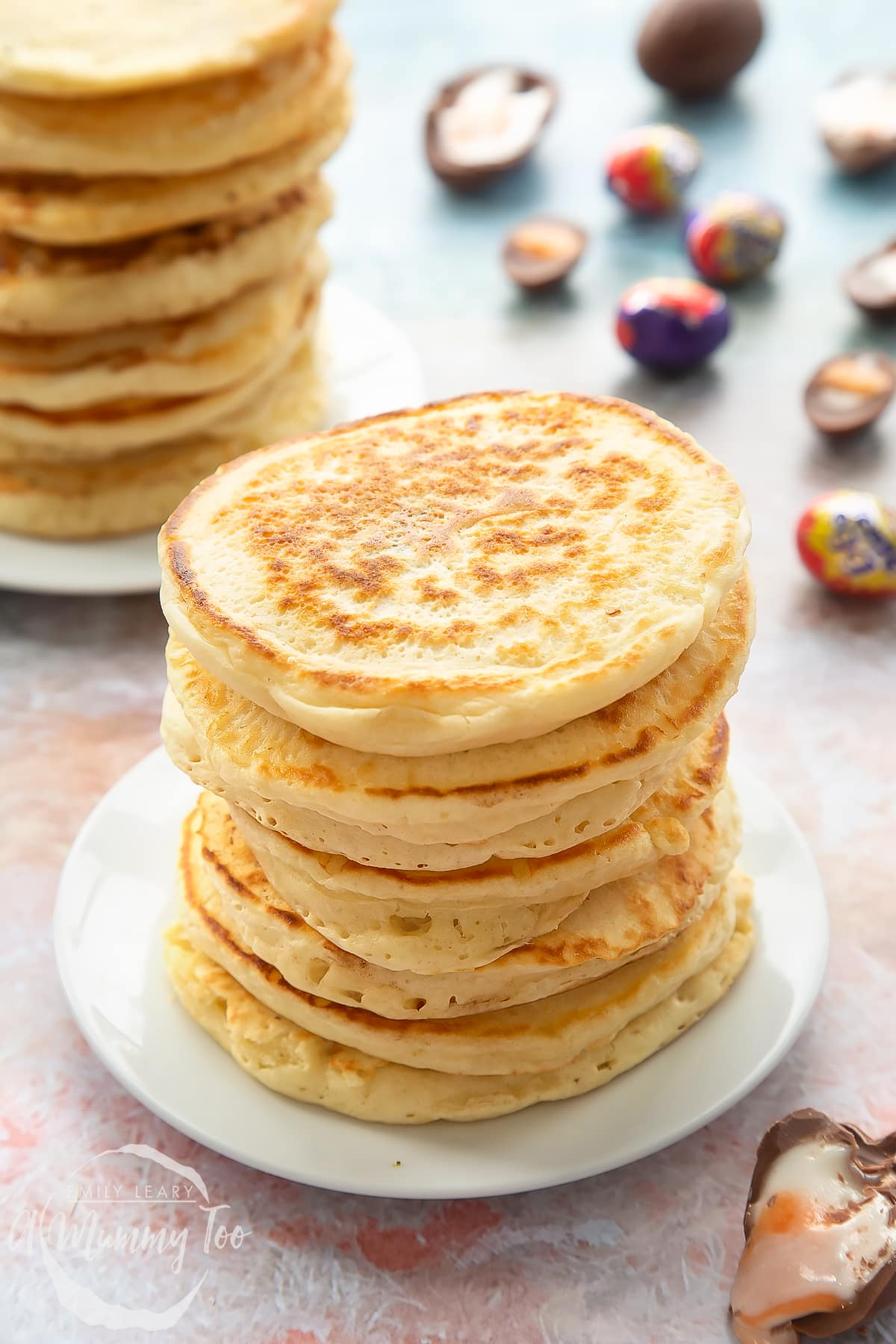 A tall stack of Creme Egg pancakes on a small white plate.