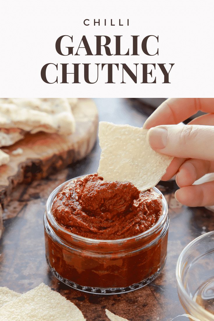 graphic text step-by-step recipe GARLIC CHUTNEY above Overhead shot of a hand holding a piece of bread dipped into garlic puree with website URL below