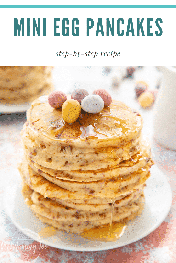 Tall, fluffy Mini Egg pancakes on a white plate in a tall stack. They are topped with syrup and Mini Eggs. Caption reads: Mini Egg pancakes step-by-step recipe