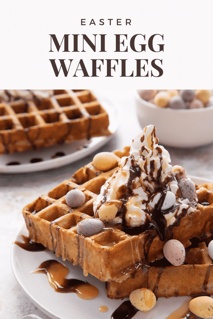 Mini egg waffles on a white plate. They are topped with squirty cream, chocolate sauce, toffee sauce and Mini Eggs. Caption reads: Easter Mini Egg Waffles