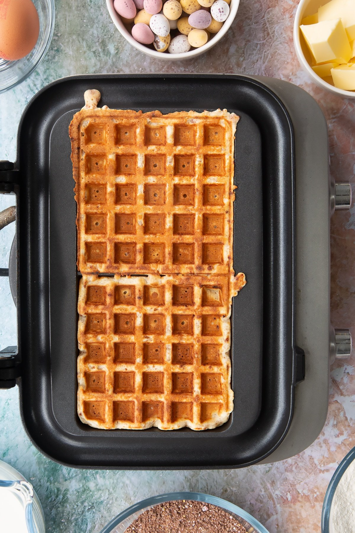 Mini Egg waffles, freshly cooked in a waffle maker.