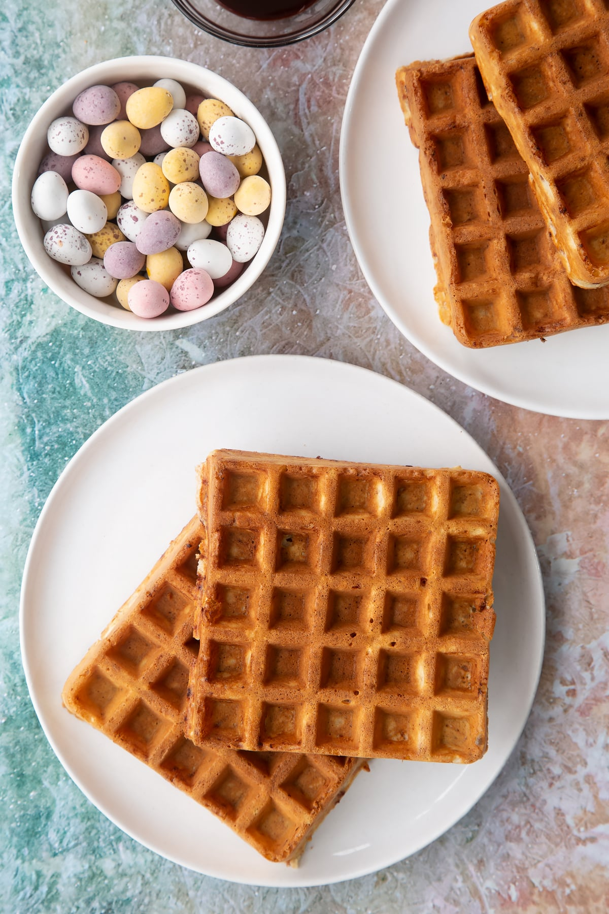 Mini egg waffles on a white plate.