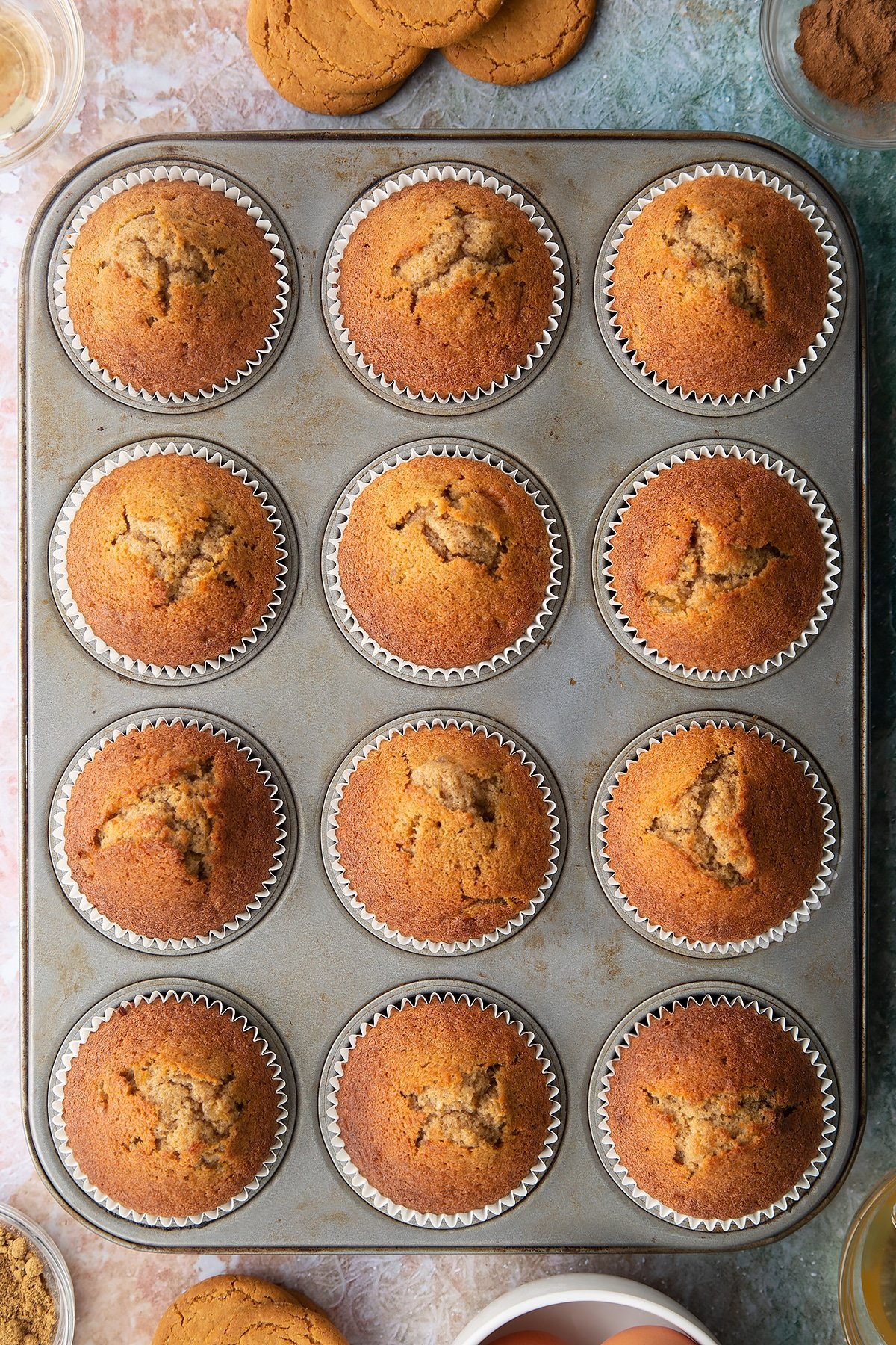 Ginger cupcakes freshly baked in a muffin tin.