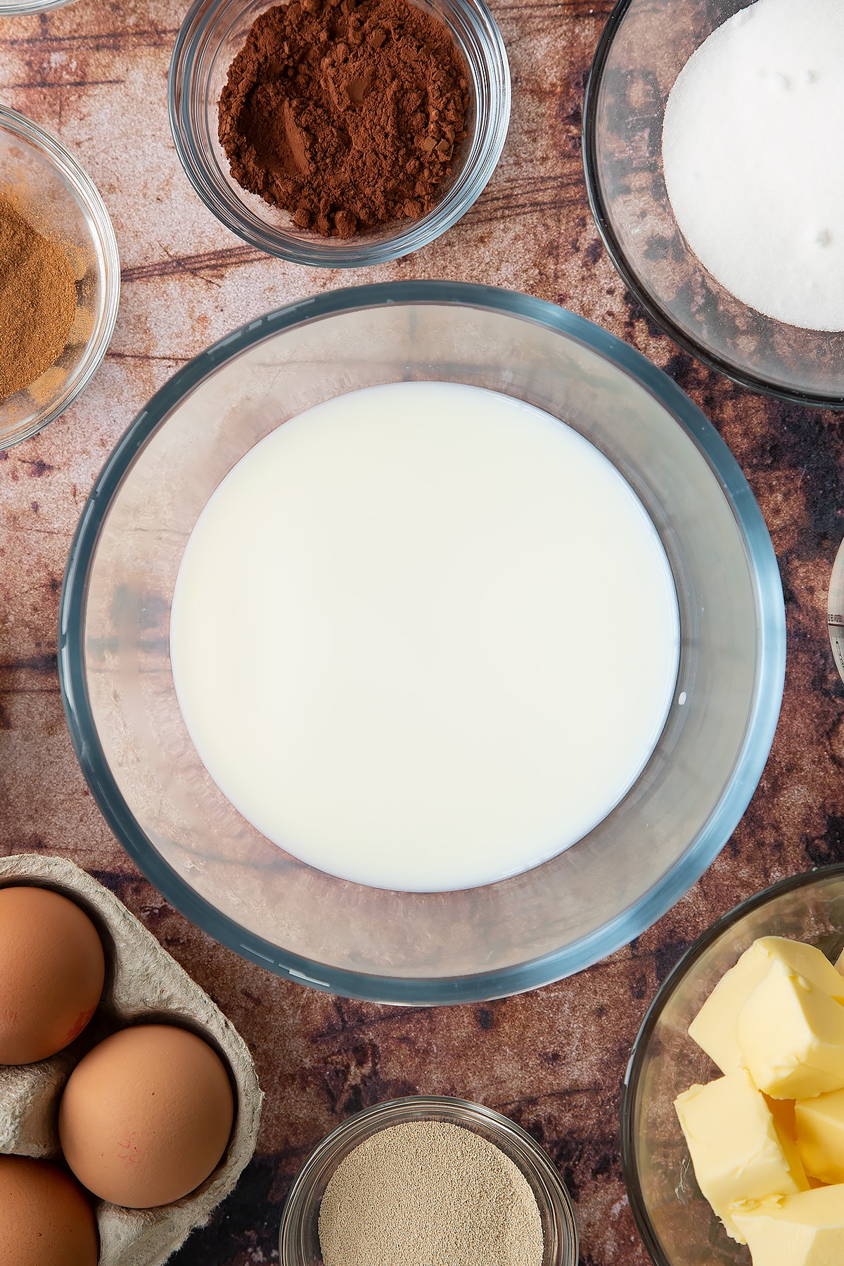 Overhead shot of milk in a large clear bowl
