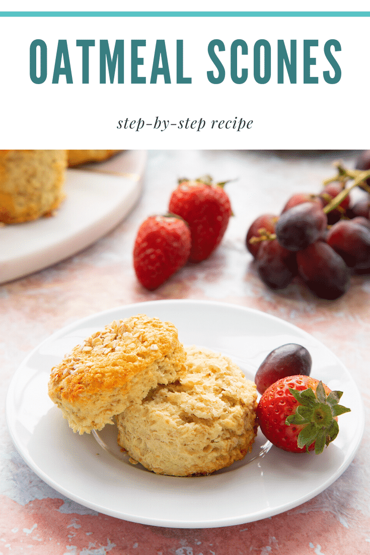 Oatmeal scone on a white plate. It has been split. Caption reads: Oatmeal Scones step-by-step recipe