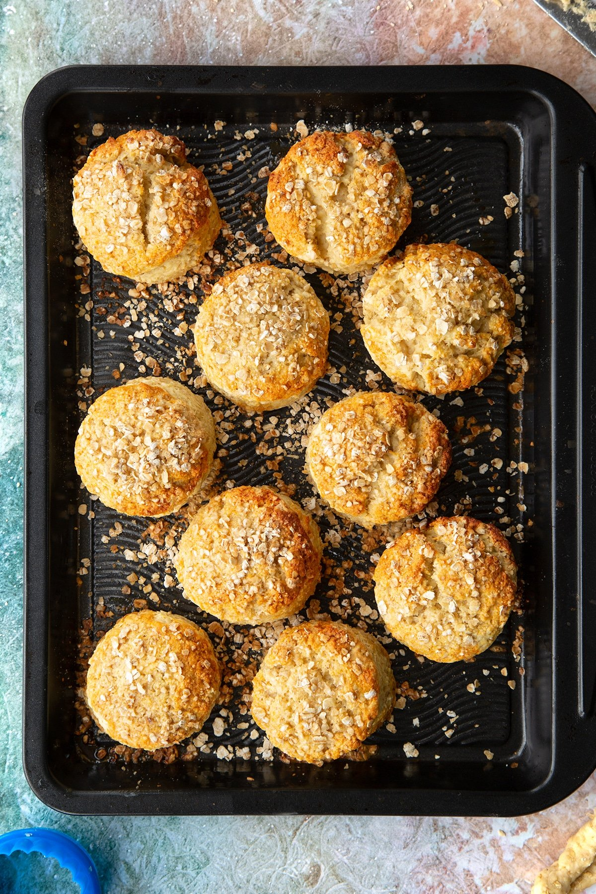 Freshly baked oatmeal scones on a baking tray.