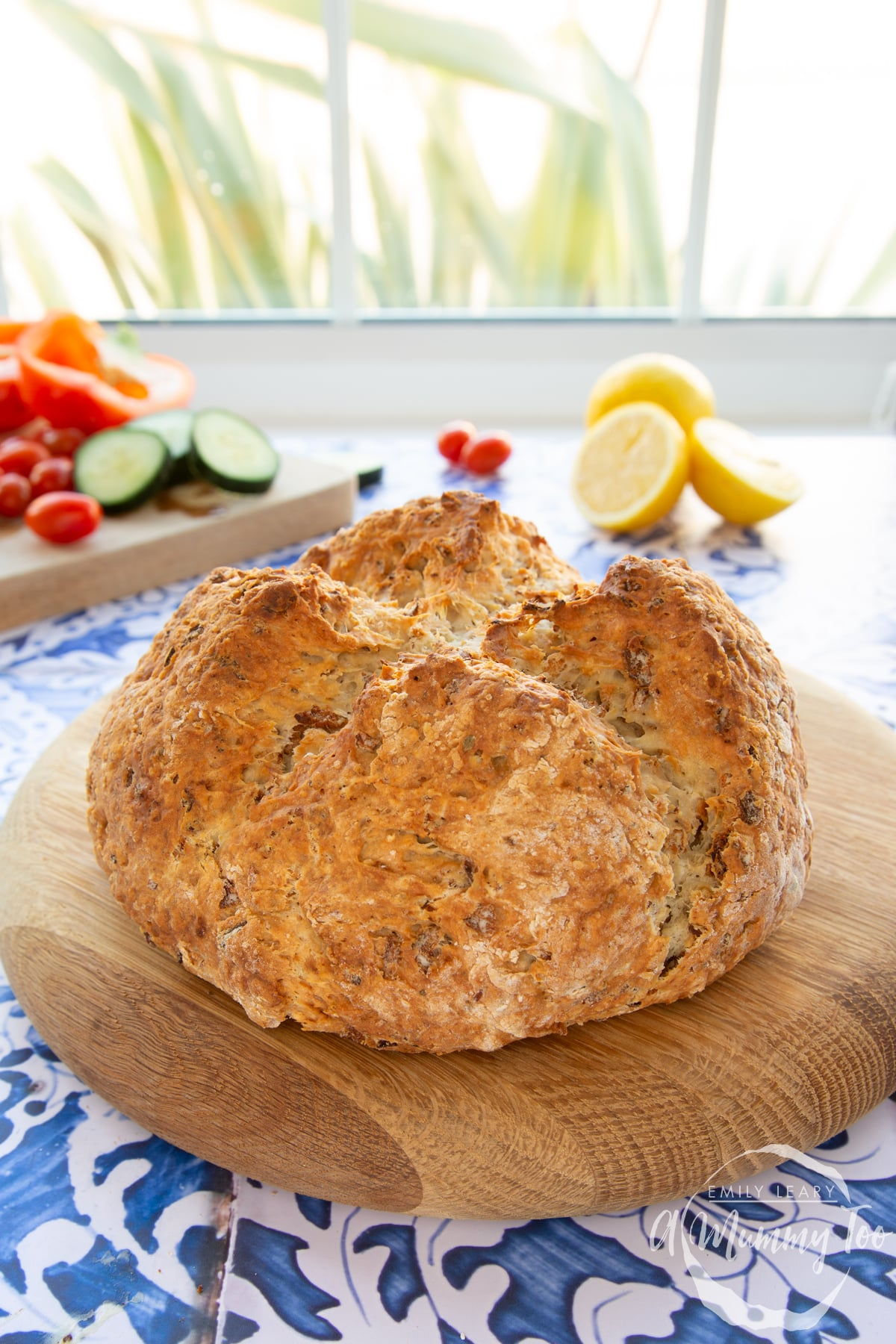 A loaf of onion soda bread on a wooden board.